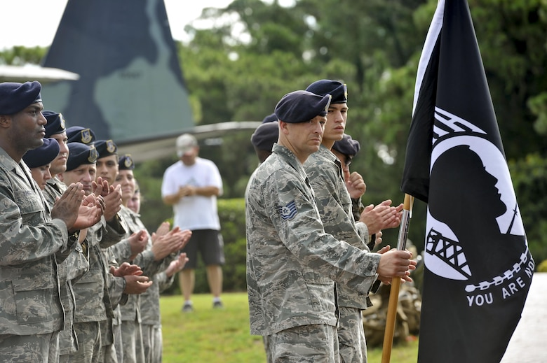 Defenders with the 1st Special Operations Security Forces Squadron applaud during a POW-MIA ceremony at the Air Park on Hurlburt Field, Fla., Sept. 16, 2016. A 24-hour ruck-vigil was performed in remembrance of prisoners of war and those identified as missing in action. (U.S. Air Force photo by Airman Dennis Spain)