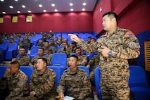 Mongolian Armed Forces soldier Maj. Ganzorig speaks to Mongolian soldiers and U.S. Marines during the lessons learned training portion of Non-Lethal Weapons Executive Seminar (NOLES) 2016 at the Five Hills Training Area, Mongolia, Sept. 14, 2016. Ganzorig is an oppression officer for the 345th Infantry Brigade. Mongolian service members shared past non-lethal weapons experiences during the lessons learned training. NOLES is a regularly scheduled field training exercise and leadership seminar hosted annually by various nations throughout Asia-Pacific.
