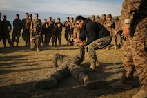 U.S. Marine Cpl. Ezequiel Silva demonstrates mechanical advantage control holds techniques to Mongolian Armed Forces soldiers and Mongolian National Police during Non-Lethal Executive Seminar (NOLES) 2016 at the Five Hills Training Area, Mongolia, Sept. 16, 2016. Silva is a military police Marine with 3rd Law Enforcement Battalion, III Marine Expeditionary Force. Mongolian soldiers and police learned mechanical advantage control holds techniques as an additional non-lethal option when apprehending suspects. NOLES is a regularly scheduled field training exercise and leadership seminar hosted annually by various nations throughout Asia Pacific. (U.S. Marine Corps photo by Cpl. Jonathan E. LopezCruet)