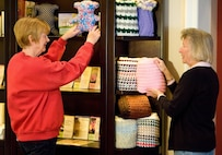 Janet King, Friends of the Fallen donation coordinator, and Ellie Dill, Friends of the Fallen volunteer replenish a teddy bear and comfort shawl at the Center for Families of the Fallen, Dover AFB, Delaware March 31, 2016. The shawls and bears are available at no cost for families traveling to Dover for a dignified transfer of a loved one through donations from across the nation to support families of the fallen. (U.S. Air Force photo/Roland Balik)