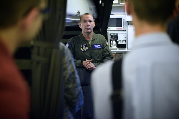 Tech. Sgt. Phillip Robbins, flight attendant with the 73rd Airlift Squadron speaks with Air Force ROTC cadets from the University of Louisville, Kentucky, Detachment 295, during a visit to Scott Air Force Base, Sep. 16, 2016. The cadets toured a C-40C and a C-21 as well as spoke with pilots, flight attendants and maintenance technicians who answered questions and shared information about Scott AFB and their Air Force careers. (U.S. Air Force photo by Christopher Parr)