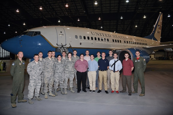 Air Force ROTC cadets from the University of Louisville, Kentucky, Detachment 295 pose with Tech. Sgt. Phillip Robbins, far left,  73rd Airlift Wing flight attendant and Capt. Thomas Carr, far right, assistant director of operations, 458th Airlift Squadron, Scott Air Force Base, Sep. 16, 2016.  (U.S. Air Force photo by Christopher Parr)