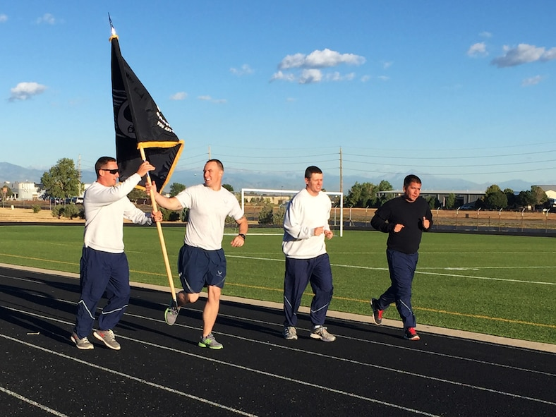 Members of Team Buckley participate in a 24-hour POW/MIA memorial run Sept. 15, 2016, at an outdoor track on Buckley Air Force Base, Colo. National POW/MIA Recognition Day is an annual event observed across the United States every third Friday of September. (U.S. Air Force photo by Airman 1st Class Gabrielle Spradling/Released)