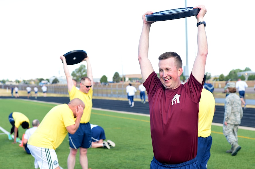 Col. Matthew Hanson, 460th Medical Group commander, participates in Warfit after a 24-hour POW/MIA memorial run Sept. 16, 2016, at the outdoor track on Buckley Air Force Base, Colo. Warfit provides an opportunity for all members of Team Buckley to come together and participate in a workout designed by the fitness center instructors. (U.S. Air Force photo by Airman 1st Class Gabrielle Spradling/Released)