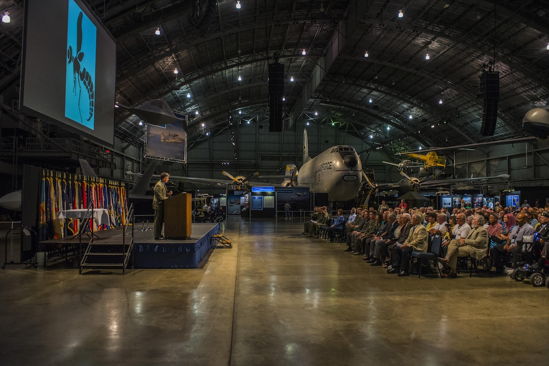 A crowd of military veterans, current military members, family and friends listen during the Green Hornet Dedication ceremony at the National Museum of the United States Air Force near Wright-Patterson Air Force Base, Ohio, Sept. 15, 2016. More than 300 people were in attendance of the ceremony which honored veterans of the 20th Special Operations Squadron with an exhibit and diorama depicting their rescue mission in Vietnam on Nov. 26, 1968. (U.S. Air Force photo by Senior Airman Luke Kitterman/Released)