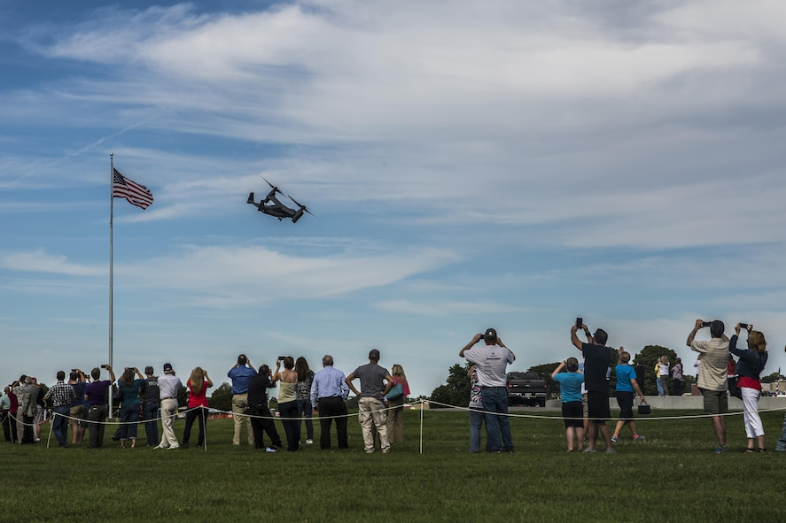 A CV-22 Osprey aircraft assigned to the 20th Special Operations Squadron at Cannon Air Force Base, N.M., provides a fly over for the public after the Green Hornet Dedication ceremony at the National Museum of the United States Air Force near Wright-Patterson Air Force Base, Ohio, Sept. 15, 2016. The aircraft landed at the museum in tribute to the Green Hornets. (U.S. Air Force photo by Senior Airman Luke Kitterman/Released)