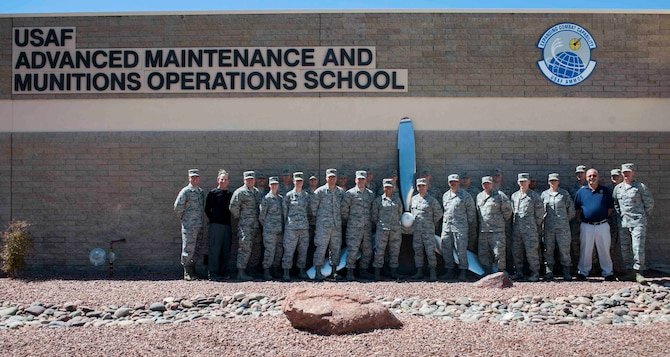Students and cadre of the Advanced Sortie Production Course at the U.S. Air Force Advanced Maintenance and Munitions Operations School on Nellis Air Force Base, Nev., pose for a group photo Sept. 13, 2016. Throughout the inaugural 12 week course, the ASPC will provide graduate level instruction to develop highly skilled officers in the art of sortie production processes at the tactical level. (U.S. Air Force photo by Senior Airman Jake Carter)