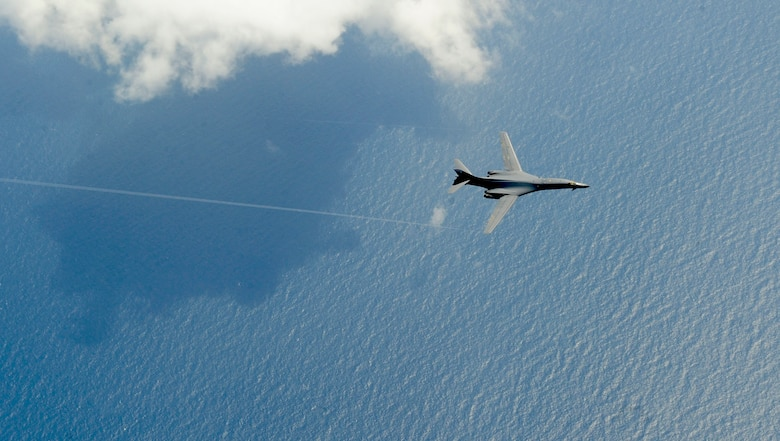 """A B-1B Lancer from Dyess Air Force Base, Texas, flies over the Atlantic Ocean before refueling from a KC-135 assigned to the 100th Air Refueling Wing, Royal Air Force Mildenhall, England, July 31, 2012. The B-1, commonly referred to as the """"Bone,"""" is exceptionally versatile and has a synthetic aperture radar that is capable of tracking, targeting and engaging moving vehicles as well as self-targeting and terrain-following modules. (U.S. Air Force photo/Senior Airman Ethan Morgan)"""