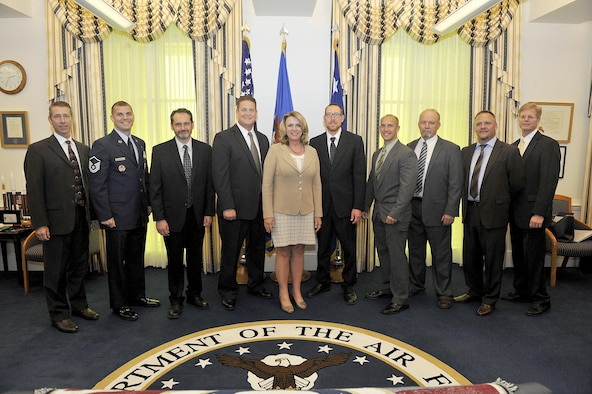 Air Force Secretary Deborah Lee James meets the Electro-Chemical Milling team, winners of the Gen. Larry O. Spencer Innovation Award, from Hill Air Force Base, Utah, during a Pentagon ceremony Sept. 16, 2016. The team is comprised of Trevor Foust, Brad Johnson, Daniel Minert, Jack Olsen, Steven Roskelley, Savanna J. Stepp, Trent Tholen, Erik Thompson, and Caleb Trammell. Master Sgt. Matthew Galinisky also won the award for his individual efforts. (U.S. Air Force photo/Tech. Sgt. Anthony Nelson Jr.)