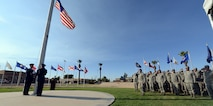 The American flag is lowered toward the end of the National POW/MIA Recognition Day vigil Sept. 16, 2016 at Luke Air Force Base, Ariz. The ceremony consisted of guest speakers and members of the 56th Fighter Wing honoring service members who are missing in action or are or were prisoners of war. (U.S. Air Force photo by Senior Airman Devante Williams)
