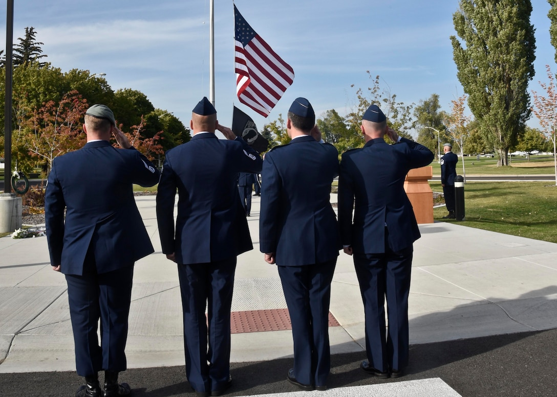 Fairchild leadership salute the American flag and the POW/MIA flag during the POW/MIA recognition day ceremony Sept. 16, 2016, at Fairchild Air Force Base, Wash. The ceremony was to honor American Prisoners of War and those Missing in Action.(U.S. Air Force photo/Airman 1st Class Taylor Shelton)