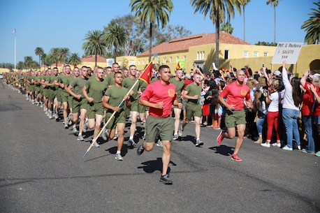 Marines of Charlie Company, 1st Recruit Training Battalion, run in formation during their motivation run at Marine Corps Recruit Depot San Diego, Sept. 15. After the Marines graduate recruit training, they receive 10 days of leave before reporting to the School of Infantry at Marine Corps Base Camp Pendleton, Calif. Annually, more than 17,000 males recruited from the Western Recruiting Region are trained at MCRD San Diego. Charlie Company is scheduled to graduate Sept. 16.