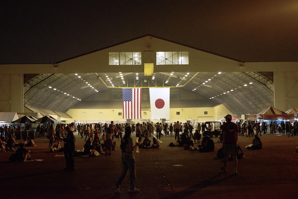 Visitors gather in a hanger to hear the Air Force Band play at the Friendship Festival on 17 Sept. 2016 at Yokota Air Base, Japan. The festival had many bands playing throughout the day on two different stages. (U.S. Air Force photo by Airman 1st Class Donald Hudson/Released)
