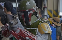 A person dressed as Boba Fett, a Star Wars movie character, poses for a picture during the Friendship Festival at Yokota Air Base, Japan, Sept. 17, 2016. The festival is designed to bolster the bilateral relationship shared between the United States and Japan. (U.S. Air Force photo by Senior Airman David Owsianka/Released)