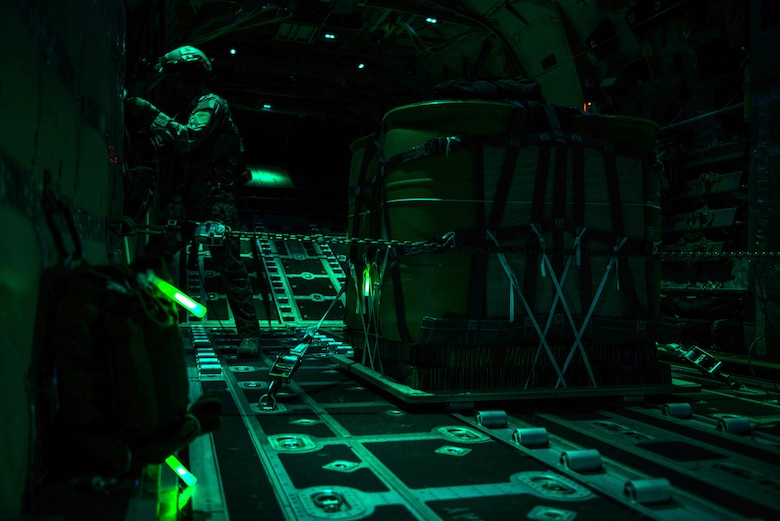 An MC-130J Commando II loadmaster, assigned to the 67th Special Operations Squadron, runs checklist procedures prior to an air drop during a night training mission on RAF Mildenhall, England, Sept. 14, 2016. Enlisted loadmasters are an essential part of an MC-130J aircrew and perform a variety of tasks from the rear of the aircraft before, during and after flights.  (U.S. Air Force photo by 1st Lt Chris Sullivan/Released)