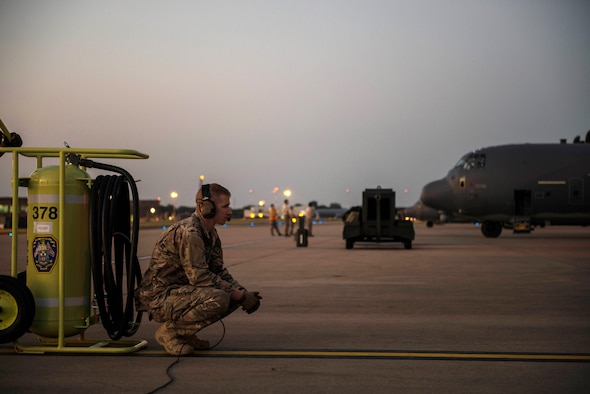 An MC-130J Commando II loadmaster, assigned to the 67th Special Operations Squadron, talks with pilots while performing engine run tests prior to a night take-off on RAF Mildenhall, England, Sept. 14, 2016. Maintainers from the 352d Special Operations Aircraft Maintenance Squadron and aircrews from the 67 SOS perform inspections and tests prior to take-off in order to ensure the aircraft are ready to perform under mission demands. (U.S. Air Force photo by 1st Lt Chris Sullivan/Released)