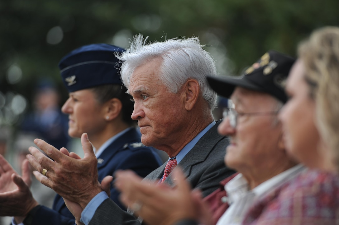 U.S. Air Force Lt. Col. (Ret.) Barry Bridger, former 43rd Tactical Fighter Squadron F-4 Phantom aircraft commander, claps during a POW/MIA closing ceremony at Joint Base Langley-Eustis, Va., Sept. 15, 2016. Bridger was shot down, captured and imprisoned for 2,232 days (six years) during the Vietnam War. The third Friday in September has been observed as POW/MIA Recognition Day since 1986. Since World War I, more than 150,000 Americans have been held as prisoners of war and more than 83,400 service members are still unaccounted for. (U.S. Air Force photo by Staff Sgt. Nick Wilson)