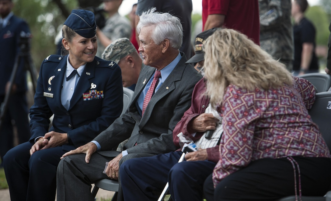 Col. Caroline M. Miller, 633rd Air Base Wing commander, shares a laugh with U.S. Air Force Lt. Col. (Ret.) Barry Bridger, former 43rd Tactical Fighter Squadron F-4 Phantom aircraft commander, during a POW/MIA closing ceremony at Joint Base Langley-Eustis, Va., Sept. 16, 2016. Bridger was shot down, captured and imprisoned for 2,232 days (six years) during the Vietnam War. The third Friday in September has been observed as POW/MIA Recognition Day since 1986. Since World War I, more than 150,000 Americans have been held as prisoners of war and more than 83,400 service members are still unaccounted for. (U.S. Air Force photo by Staff Sgt. Nick Wilson)