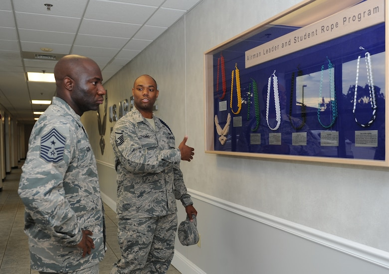 Master Sgt. James Thomas, 81st Training Group military training leader, briefs Chief Master Sgt. Vegas Clark, 81st Training Wing command chief, on the Airman leader and student rope program during an immersion tour at the Levitow Training Support Facility Sept. 12, 2016, on Keesler Air Force Base, Miss.  The purpose of the tour was to become familiar with the 81st TRG's mission, operations and personnel. (U.S. Air Force photo by Kemberly Groue/Released)