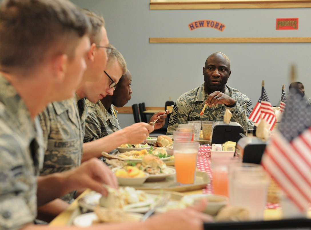 Chief Master Sgt. Vegas Clark, 81st Training Wing command chief, has lunch with Airmen from the 81st Training Group at the Magnolia Dining Facility during an immersion tour Sept. 12, 2016, on Keesler Air Force Base, Miss.  The purpose of the tour was to become familiar with the 81st TRG's mission, operations and personnel. (U.S. Air Force photo by Kemberly Groue/Released)