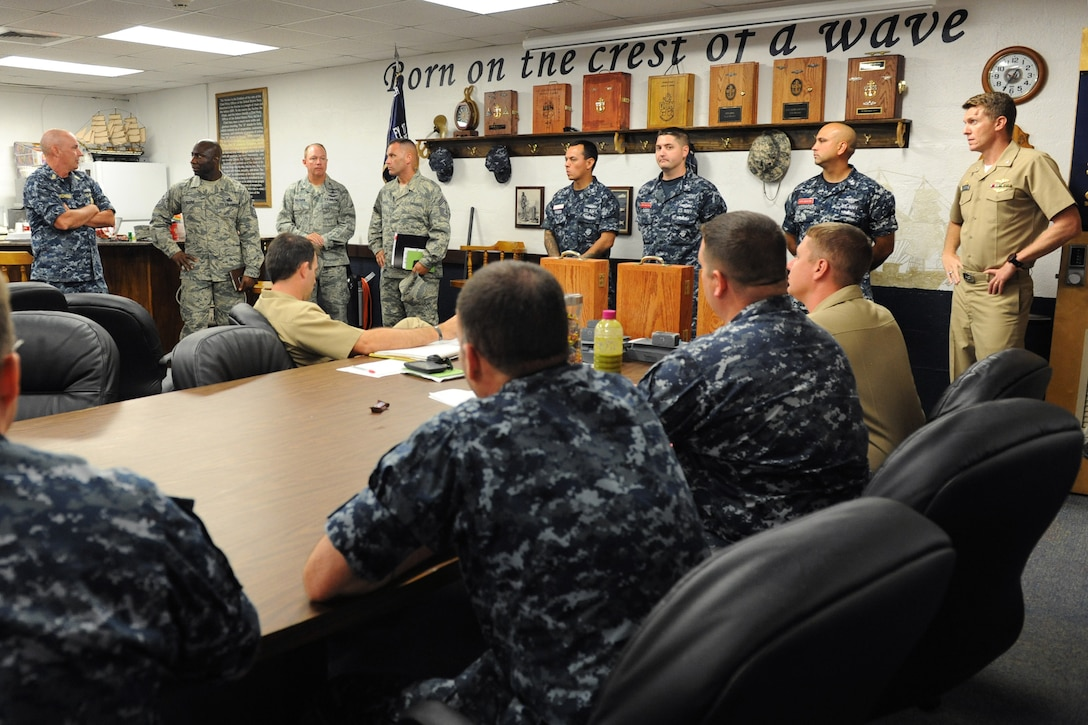 Chief Master Sgt. Vegas Clark, 81st Training Wing command chief, tours the Center for Naval Aviation Technical Training Unit Keesler at Allee Hall during an immersion tour Sept. 12, 2016, on Keesler Air Force Base, Miss.  The purpose of the tour was to become familiar with the 81st Training Group's mission, operations and personnel. (U.S. Air Force photo by Kemberly Groue/Released)