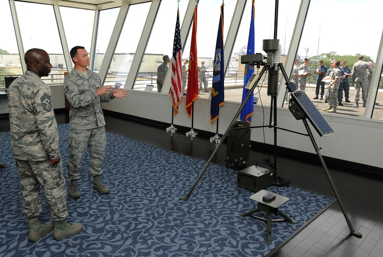 Chief Master Sgt. Vegas Clark, 81st Training Wing command chief, receives a briefing from Tech. Sgt. Dominick Martin, 335th Training Squadron advanced weather management course instructor, at the weather training complex observatory during an immersion tour Sept. 12, 2016, on Keesler Air Force Base, Miss.  The purpose of the tour was to become familiar with the 81st Training Group's mission, operations and personnel. (U.S. Air Force photo by Kemberly Groue/Released)