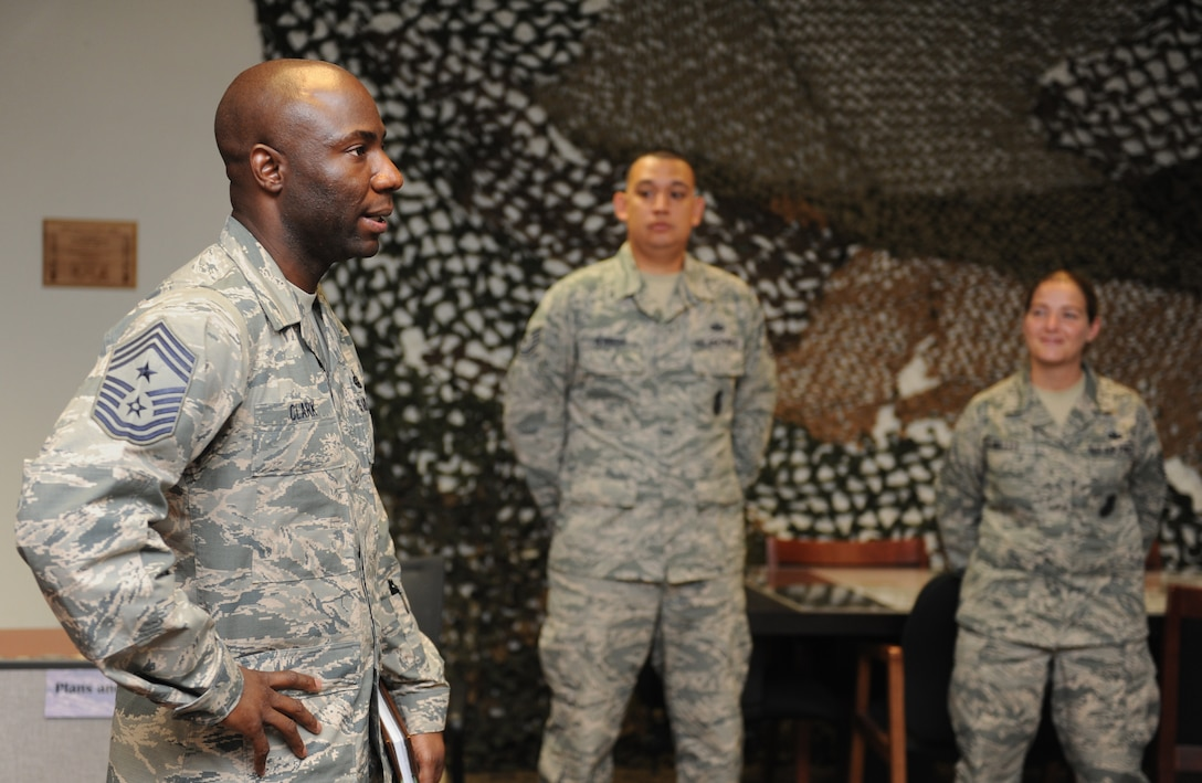 Chief Master Sgt. Vegas Clark, 81st Training Wing command chief, visits 81st Security Forces Squadron defenders during an immersion tour Sept. 8, 2016, on Keesler Air Force Base, Miss.  The purpose of the tour was to become familiar with the 81st Mission Support Group's mission, operations and personnel. (U.S. Air Force photo by Kemberly Groue/Released)