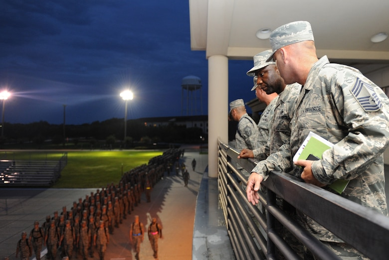 Chief Master Sgt. Vegas Clark, 81st Training Wing command chief, and 81st Training Group leadership observe morning formation from the Levitow Training Support Facility during an immersion tour Sept. 12, 2016, on Keesler Air Force Base, Miss.  The purpose of the tour was to become familiar with 81st TRG's mission, operations and personnel. (U.S. Air Force photo by Kemberly Groue/Released)