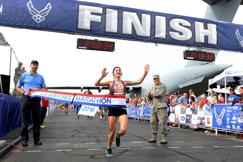 Rachel Harley from Birmingham, Ala., crosses the finish line to become the winner of the 20th U.S. Air Force Marathon women's full marathon division at Wright-Patterson Air Force Base, Ohio, with a time of 2:58:34. (U.S. Air Force courtesy photo)