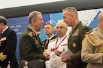 Turkey's chief of defense, Gen. Hulusi Akar, left, and Marine Corps Gen. Joe Dunford, the chairman of the Joint Chiefs of Staff, talk between sessions during the NATO Military Committee conference in Split, Croatia, Sept. 17, 2016. The alliance's chiefs of defense discussed current events and implementing the decisions made at the recent NATO summit. DoD photo by D. Myles Cullen