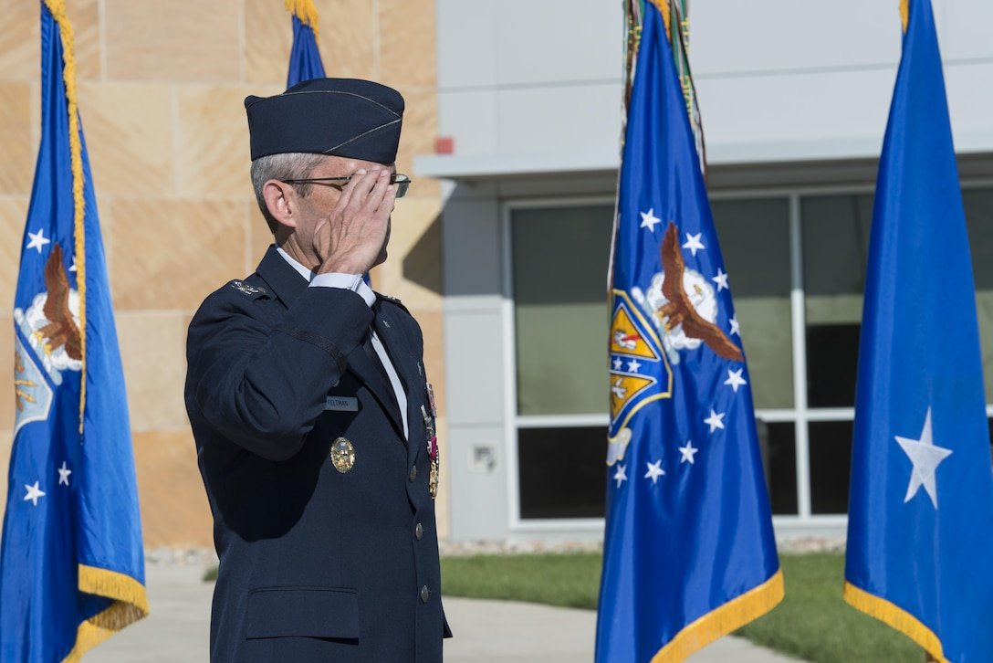 Maj. Gen. Richard W. Scobee, 10th Air Force commander, presents Col. Damon S. Feltman with the Legion of Merit award for his service during the colonel's time as commander of the 310th Space Wing during a change of command ceremony, Schriever AFB, Colo., Sept. 17, 2016. (U.S. Air Force photo by Staff Sgt. Christopher Moore/Released)