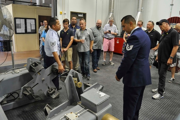 Tech Sgts. Victor Fernandez, left, and Charlie Morales, 433rd Maintenance Squadron aerospace wheel and tire technicians, demonstrate equipment used by the wheel and tire shop to 433rd Airlift Wing honorary commanders Sept. 17, 2016 during a tour of the 433rd Maintenance Group at Joint Base San Antonio-Lackland, Texas. The Airmen use the equipment to maintain and perform safety checks of the tires of the C-5M Super Galaxy. (U.S. Air Force photo/Senior Airman Bryan Swink)