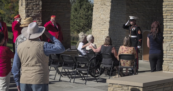 A Marine presents Anne Rissman with a flag during her life-long husband's funeral Aug. 22, 2016, at the Idaho State Veterans Cemetery in Garden City, Idaho. Jim Rissman, Anne's husband, served in the U.S. Marine Corps during World War II. Anne and Jim met shortly after WWII while attending Michigan University, using their G.I. Bill, at the beginning of their sophomore year, and were married later that year. (U.S. Air Force photo by Tech. Sgt. Samuel Morse)