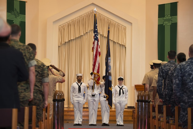 A U.S. Navy Color Guard, presents the colors during a promotion ceremony in the Marine Memorial Chapel at Marine Corps Air Station Iwakuni, Japan, Sept. 16, 2016. The colors are a part of every traditional ceremony and honor the beliefs in which each branch of service was founded upon. (U.S. Marine Corps photo by Lance Cpl. Joseph Abrego)