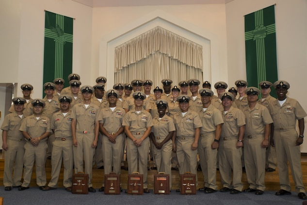 U.S. Navy Sailors pose for a group photo during a promotion ceremony in the Marine Memorial Chapel at Marine Corps Air Station Iwakuni, Japan, Sept. 16, 2016. The newly promoted chief petty officers were joined by their peers as a sign of becoming something bigger than themselves. (U.S. Marine Corps photo by Lance Cpl. Joseph Abrego)