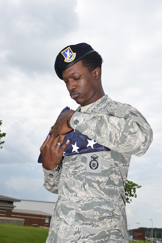 Senior Airman Scott folds the American flag in accordance with customs during Retreat on August 7, 2016 at Memphis Air National Guard Base in Memphis, TN. (U.S. Air National Guard photo by Master Sergeant Danial Mosher/Released)