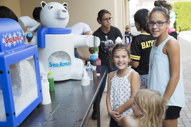 Children wait for shaved ice during the Boys and Girls Club Day for Kids Celebration 2016 at Marine Corps Air Station Iwakuni, Japan, Sept. 17, 2016. All kids, 17 years of age and younger, were invited out for entertainment, food and beverages with the local community. (U.S. Marine Corps photo by Lance Cpl. Joseph Abrego)
