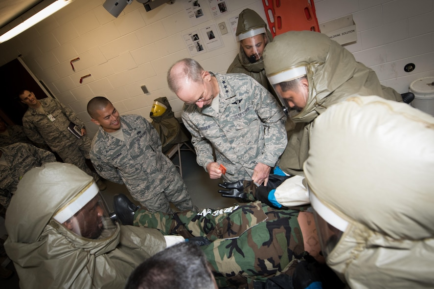 Lt. Gen. (Dr.) Mark A. Ediger, Surgeon General of the Air Force, Headquarters U.S. Air Force, Washington, D.C., practices contingency medical procedures with 51st Medical Group Airmen Sept. 14, 2016, at Osan Air Base, Republic of Korea. Ediger toured various medical facilities within the group to observe the progress and challenges of AF military treatment facilities. (U.S. Air Force photo by Senior Airman Dillian Bamman)