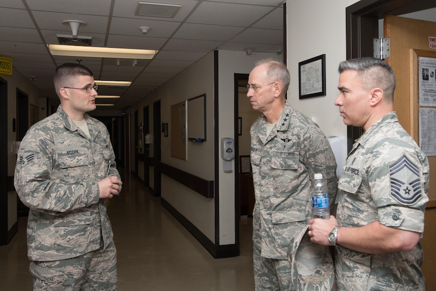 U.S. Air Force Senior Airman Patrick Moore, 51st Medical Operation Squadron emergency medical technician, speaks with Lt. Gen. (Dr.) Mark A. Ediger, Surgeon General of the Air Force, Headquarters U.S. Air Force, Washington, D.C., and Chief Master Sgt. Jason Pace, Office of the Surgeon General medical enlisted force chief, during a tour of the 51st Medical Group Sept. 14, 2016, at Osan Air Base, Republic of Korea. Ediger and Pace toured various medical facilities within the group to observe the progress and challenges of AF military treatment facilities. (U.S. Air Force photo by Senior Airman Dillian Bamman)