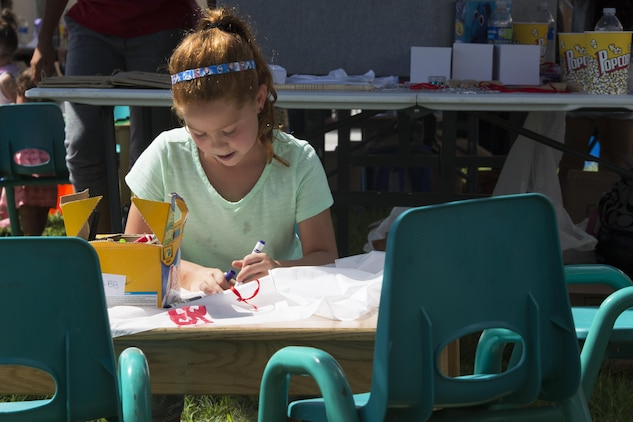 A child attending the Boys and Girls Club Day for Kids Celebration 2016 colors at Marine Corps Air Station Iwakuni, Japan, Sept. 17, 2016. Day for Kids gave children an opportunity to have fun and interact with other children in a safe environment. (U.S. Marine Corps photo by Lance Cpl. Joseph Abrego)