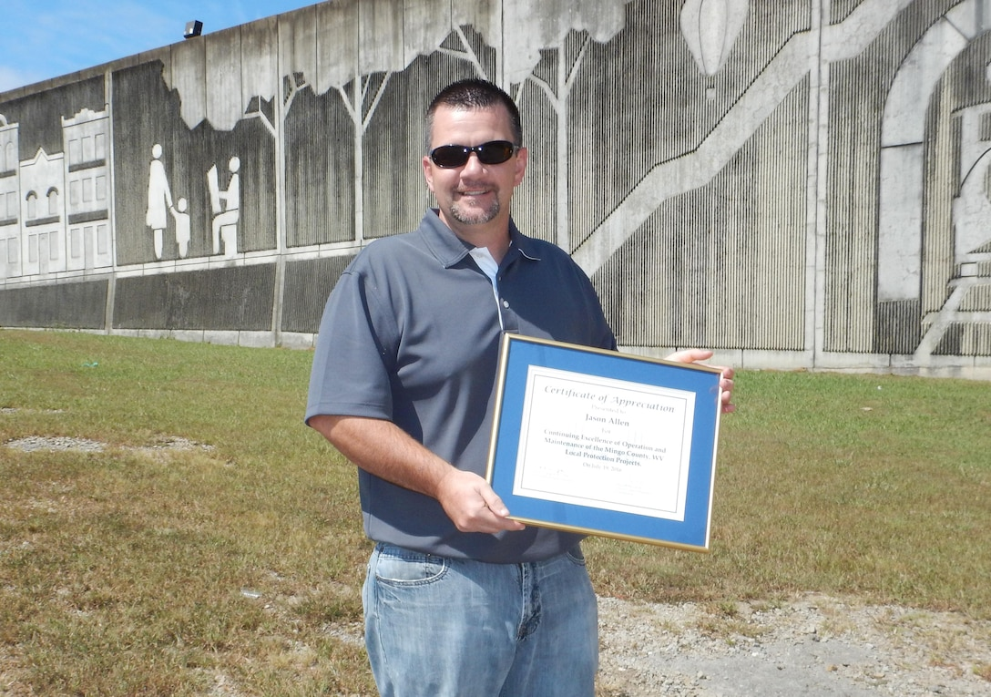 During the annual levee inspection for the Williamson and West Williamson Local Protection Projects on 15 September, Jason Allen of Veolia Water was presented an award for continuing excellence in the maintenance and operational readiness of the Mingo County, WV, floodwall/levee systems. He is notable to the Huntington Levee Safety Program staff in his thoroughness and commitment to abiding by recommendations and requirements for proper maintenance and readiness.  Always responsive, Allen has exemplified the shared responsibility of flood risk reduction and service to his community through action and organization.