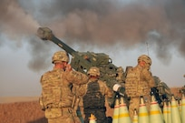 U.S Army Soldiers with Battery C, 1st Battalion, 320th Field Artillery Regiment, Task Force Strike, execute a fire mission in northern Iraq, Aug. 14 2016, during an operation to support the Iraqi army. Battery C is supporting the Iraqi security forces with indirect fires as retake territory from the Islamic State of Iraq and the Levant.  Artillery units in Iraq serve two roles: to provide force protection for Coalition and Iraqi security forces and to support ISF ground maneuver, enabling them to defeat Da'esh. (U.S. Army photo by 1st Lt. Daniel I Johnson/Released)