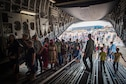 Hundreds of people line up to tour the inside of a C-17, the largest aircraft on display at the Africa Aerospace and Defense Expo at Waterkloof Air Force Base, South Africa, Sept. 17, 2016. The U.S. military is exhibiting a C-17 Globemaster III, a KC-135 Stratotanker, a C-130J Super Hercules, an HC-130 King, and an MQ-9 Reaper. The aircraft come from various Air National Guard and Air Force Reserve Command units. The U.S. routinely participates in events like AADE to strengthen partnerships with regional partners. (U.S. Air Force photo by Tech. Sgt. Ryan Crane)