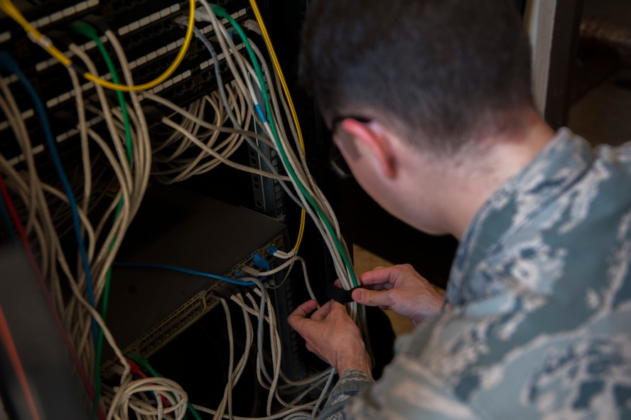 U.S. Air Force Airman 1st Class Nathan Bryant, 39th Communications Squadron cyber transport technician, ties wires together Sept. 19, 2016, at Incirlik Air Base, Turkey. Bryant performed a preventative maintenance inspection to ensure the equipment was organized and compliant with standards. (U.S. Air Force photo by Airman 1st Class Devin M. Rumbaugh)