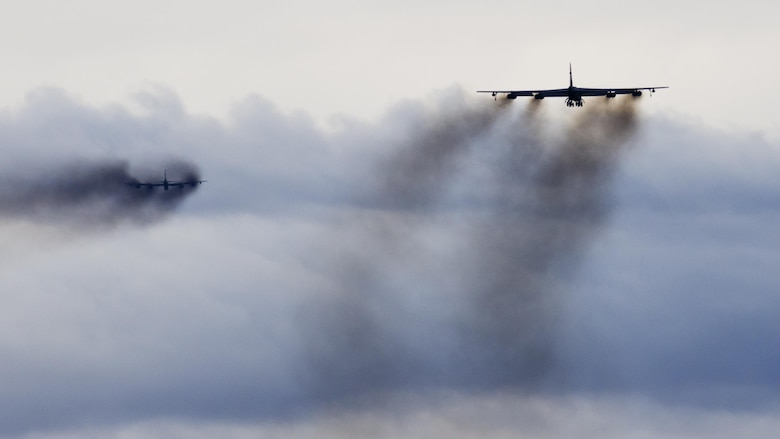 Two B-52H Stratofortresses soar through the air during Prairie Vigilance 16-1 at Minot Air Force Base, N.D., Sept. 16, 2016. The exercise concluded with the rapid fly- off, successfully launching a sequence of 12 B-52s to showcase their active capability to execute the mission. (U.S. Air Force photo/Airman 1st Class J.T. Armstrong)