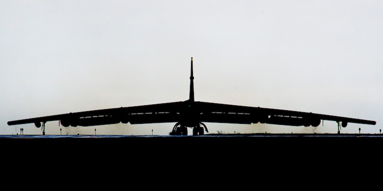 A silhouetted B-52H Stratofortress taxis down the runway during Prairie Vigilance 16-1 at Minot Air Force Base, N.D., Sept. 16, 2016. The exercise concluded with the rapid fly-off, successfully launching a sequence of 12 B-52s to showcase their active capability to execute the mission. (U.S. Air Force photo/Airman 1st Class J.T. Armstrong)