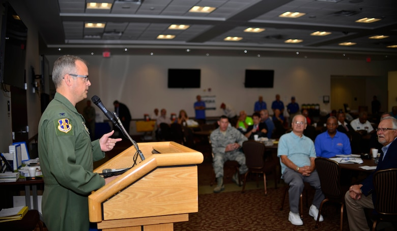 Col. Brian Bowman, 914 Airlift Wing Commander, speaks to a crowd of military retirees during Retiree Appreciation Day. The events of the day included tours of the C-130 aircraft and base, buffet lunch and retiree fair, hosted by Niagara Falls Air Reserve Station, N.Y. , September 17, 2016. (U.S. Air Force photo by Tech. Sgt. Steph Sawyer)