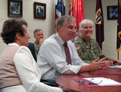 """Mr. Stephen D. Austin, Assistant Chief of Army Reserve, meets with Army Reserve Medical Command commanding general, Maj. Gen. Mary E. Link (right), and other senior leaders and staff members of ARMEDCOM in Pinellas Park, Florida at the C.W. """"Bill"""" Young Armed Forces Reserve Center on Friday, Sept. 16. ARMEDCOM enhances readiness, medical support, and medical training and is the largest medical footprint of the Army Reserve with more than 100 different medical units located throughout the United States. NOTE: Ms. Erin Thede (left), director of the Army Reserve Private Public Partnership (P3) program, joined the ACAR during the visit."""