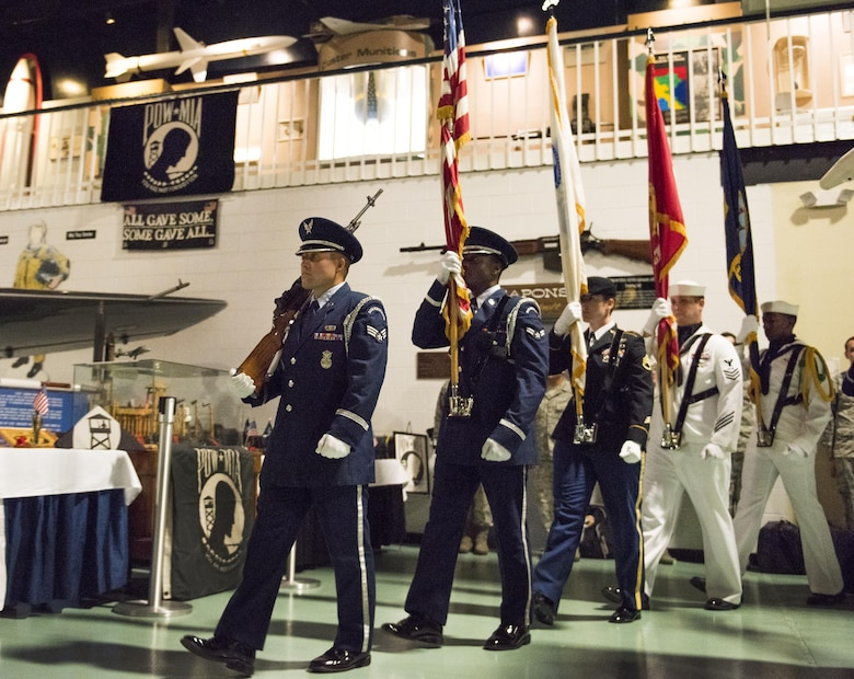 Senior Airman Keith Wheeldon leads a joint service color guard during the presentation of the colors during the POW/MIA Recognition Day ceremony Sept. 16 at the Air Force Armament Museum. The ceremony paid tribute to those military members who have yet to return home from defending America. The event featured tributes, guest speakers, honor guard procedures and a 53rd Wing F-15 and F-16 flyover. (U.S. Air Force photo/Samuel King Jr.)