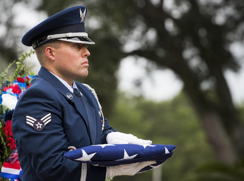 Senior Airman Keith Wheeldon, Eglin Air Force Base honor guard, holds an American flag at the POW/MIA Recognition Day event Sept. 16 at the Air Force Armament Museum. The ceremony paid tribute to those military members who have yet to return home from defending America. The event featured tributes, guest speakers and honor guard procedures. (U.S. Air Force photo/Samuel King Jr.)